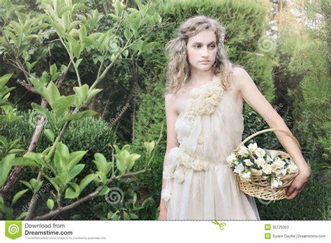 beautiful in garden in wedding gown dress stock