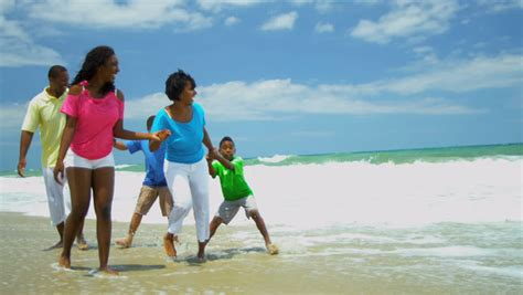 Hispanic Young Loving Family Spending Vacation On Beach Playing Soccer Shot On Red Epic Stock