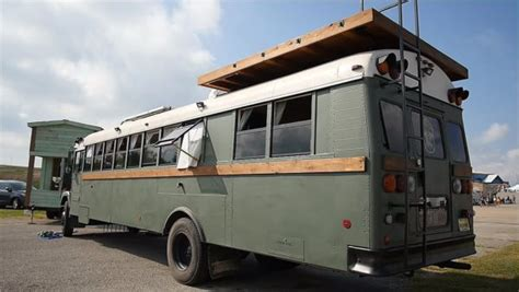 school bus conversion with a rooftop deck that sleeps six