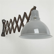 Giant scissor wall lights