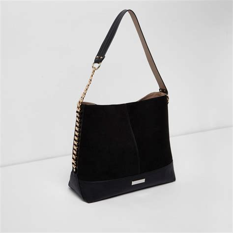 river island black chain side slouch bag lyst
