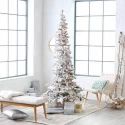 Slim Prelit Christmas Trees by Narrow Flocked Austin Pine Pre Lit Slim Christmas Tree