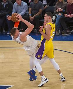 The Los Angeles Lakers' Lonzo Ball (2) trips up the New ...