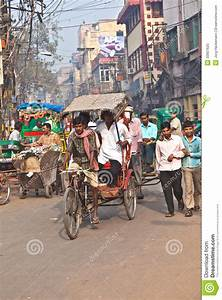 Cycle Rickshaw Driver With Passenger In Chawri Bazar ...