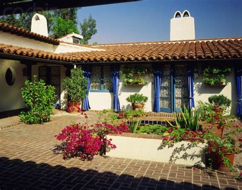 spanish style ranch homes  courtyards small lily pad covered pond  brick courtyard