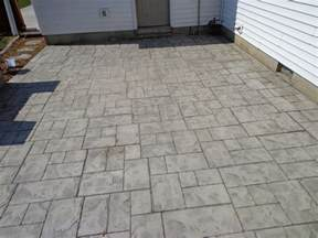 installing interlocking pavers vs sted concrete in