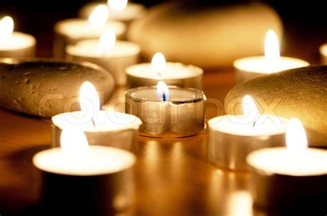 burning candles  pebbles  aromatherapy session