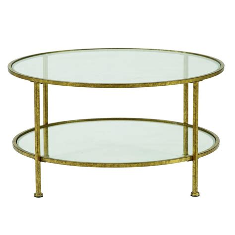 A round gold coffee table is never out of fashion. Home Decorators Collection Bella Aged Gold Coffee Table-9501200910 - The Home Depot