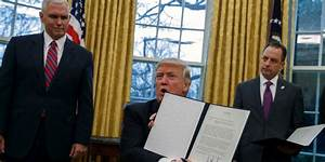 Trump's revised travel ban excludes Iraq, people with ...