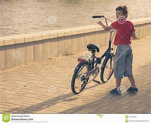 Boy With His Bicycle. Young Boy Riding Bicycle On A Summer ...