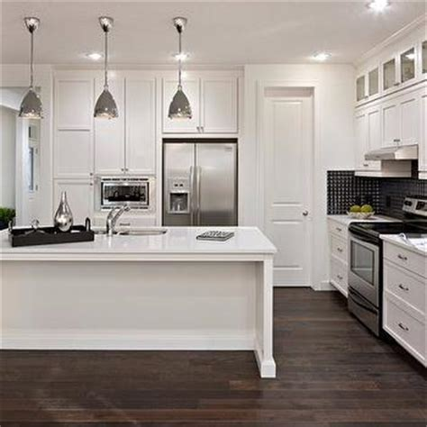 pictures of small kitchen islands white kitchen cabinets with stainless steel appliances 7487