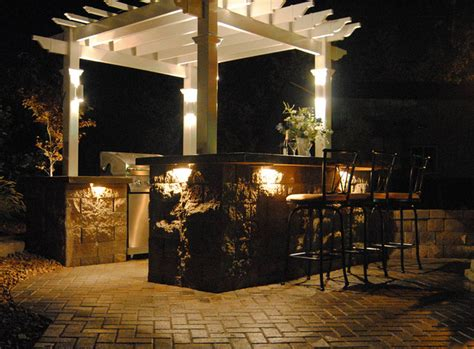 backyard bar and pergola with accent lighting