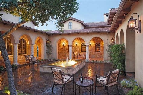 style homes with courtyards tuscan style home in austin texas atrium courtyard with fountain fascia ideas