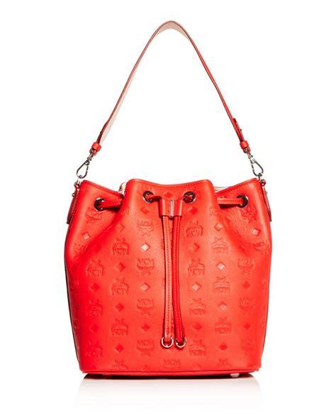 mcm essential embossed leather bucket bag  red lyst