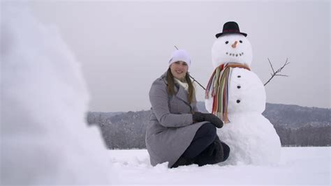 Girl Building A Snowman Stock Footage Video 3579719