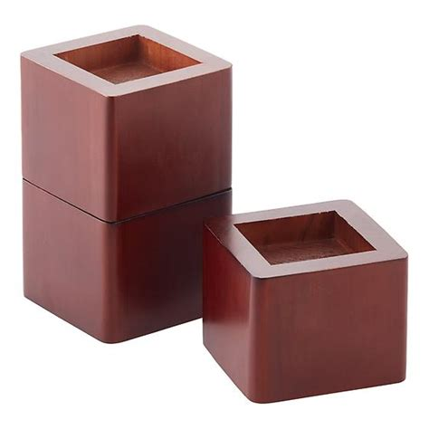 Wood Bed Risers Home Depot by Walnut Solid Wood Bed Risers The Container Store