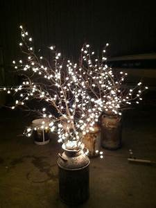 Diy why spend more milk cans branches white lights for Diy wedding reception lighting