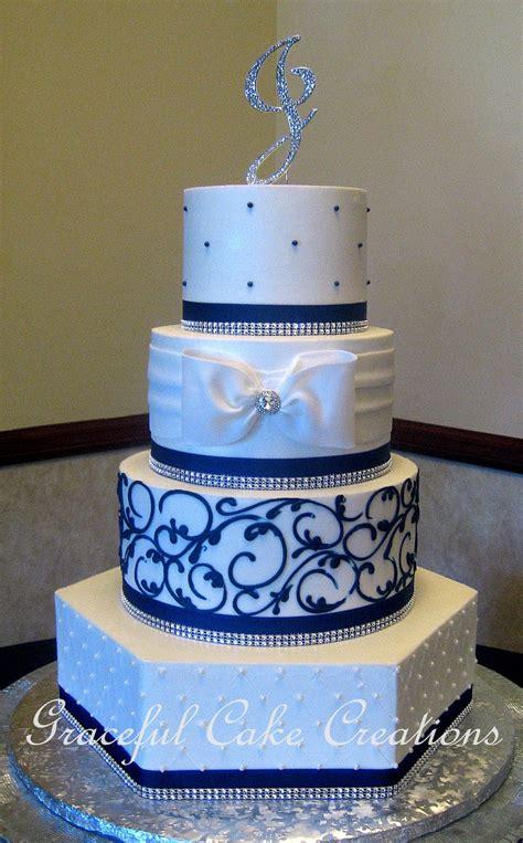 elegant white butter cream wedding cake  navy blue