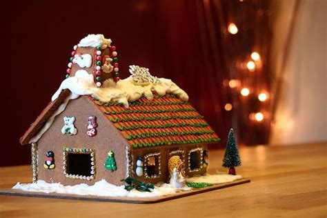 gingerbread house decorated with various fondant christmas
