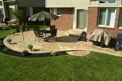 concrete patio landscaping ideas some backyard patio design ideas are a circular stone patio with wooden furniture backyard