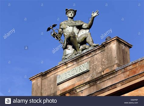 A Statue Of Mercury By Alexander Stoddart On Top Of A