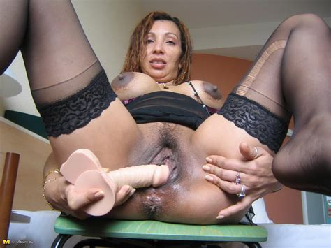 Horny mature Celeste loves playing with those toys