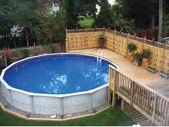 SLIDESHOW What You Can Do With An Aboveground Pool AQUA Magazine Small Front Deck Plans Home Design Ideas Fence Wooden FLoor Beautiful View Above Ground Pools With Decks Image This Above Ground Pool Deck Has An Amazing Wood And Stone Deck Skirt