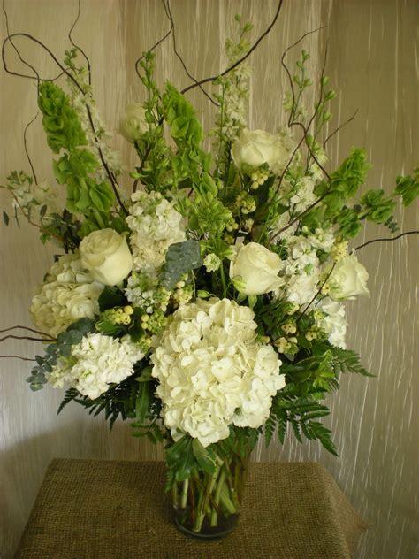 lovely head table arrangement idea  bells  ireland