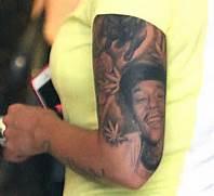 Fotos - Amber Rose Tattoos Wiz Khalifa S Face On Her Arm  Wiz Khalifa Arm Tattoos