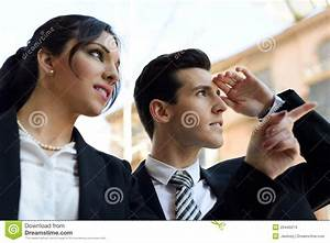 Attractive Business People Looking At Something ...