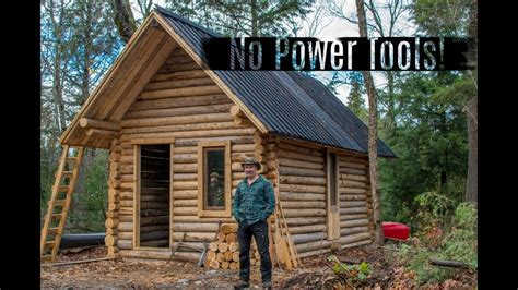 man builds  grid cabin    forest  hand tools youtube
