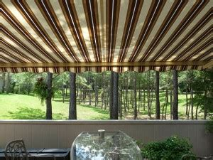 retractable awnings motorized awnings  manual awnings carroll architecture shade