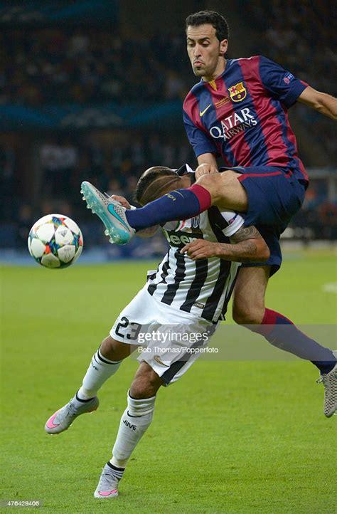 Sergio Busquets of Barcelona tackles Arturo Vidal of ...