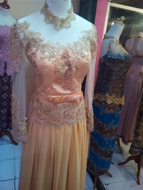 dress kebaya cantik berwarna kuning emas bahan sifon