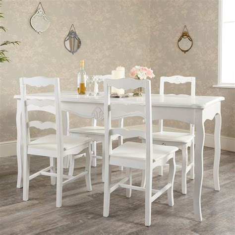 large white dining table with 4 chairs