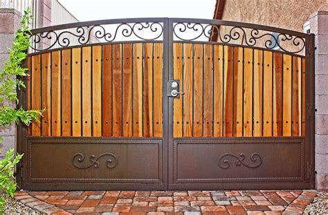 wood and iron gates designs traditional iron and wood gate by first impression security doors traditional home fencing