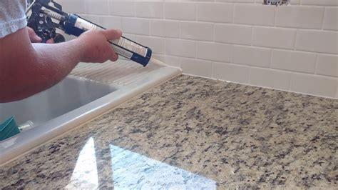 How to install silicone caulk around kitchen countertop