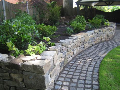 front garden paths design dressed dry stone raised planting bed and granite cobbled sett path from a design by sue davis