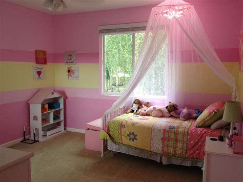 girls bedroom painted stripes of pink and green so