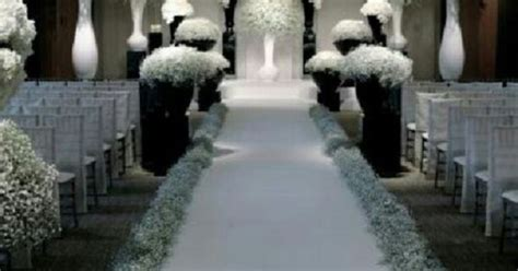 I Love The Baby's Breath Lining The Aisle.