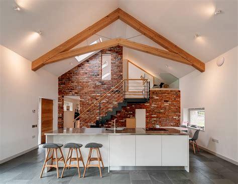 barn renovation  conversion  green oak frame truss white unit  stainless steel