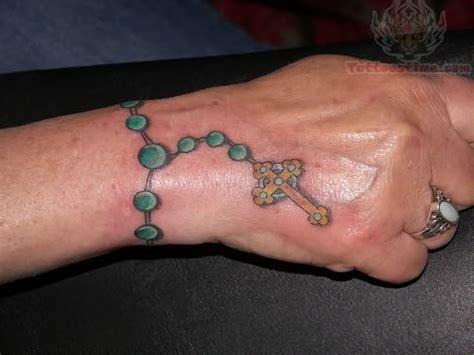 rosary tattoos  wrists