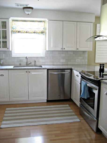 white kitchen  gray subway tile gray quartzite