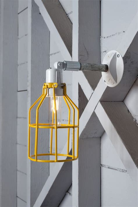 yellow cage light exterior wall sconce