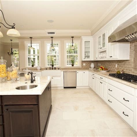kitchen floor tile light color dark island hardware accents island top white like cabs