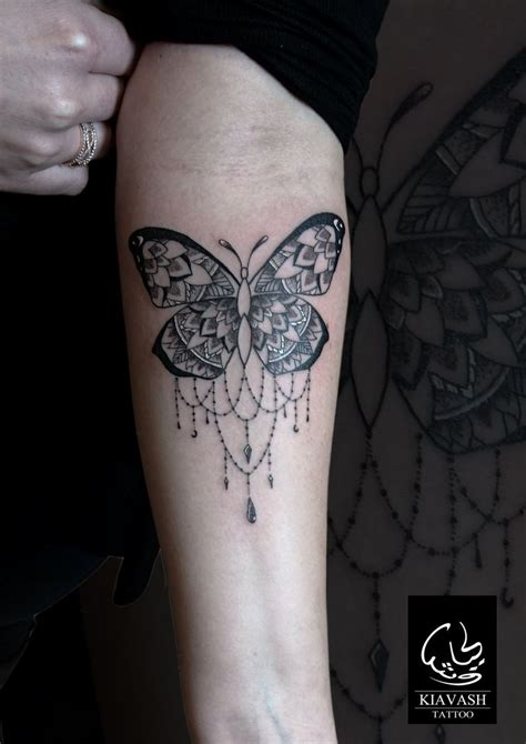 ornamental butterfly tattoo forearm girl tattoos