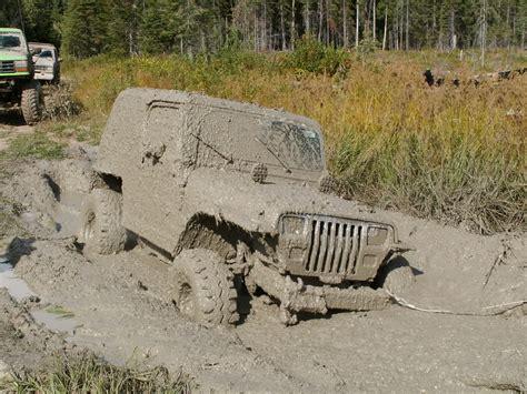 muddy jeep mudding is fun