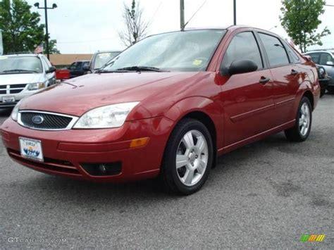 2005 sangria red metallic ford focus zx4 ses sedan