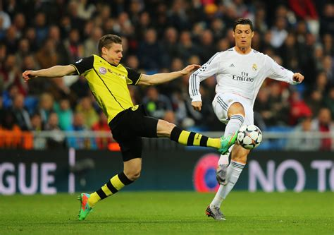 Cristiano Ronaldo is tackled by Lukasz Piszczek during the ...