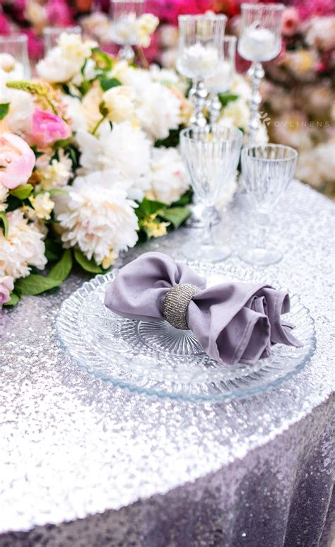 Glamorous wedding reception with sequin tablecloths and
